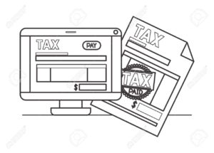 Tax document and computer screen with tax document